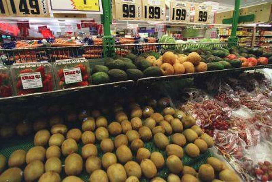 Fruits and vegetables imported from outside the country seen here at Giant Food Stores in Leesburg Virginia are kiwis,avocados,asian pears,and imported red seedless grapes. (Douglas Graham/Getty) Photo: Congressional Quarterly/Getty Im / Congressional Quarterly
