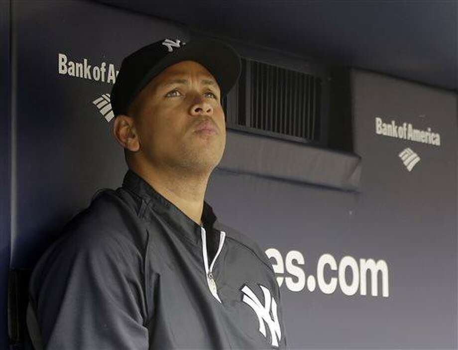 File- This April 13, 2013 file photo shows New York Yankees Alex Rodriguez sitting in the dugout during a baseball game at Yankee Stadium in New York. (AP Photo/Kathy Willens, File) Photo: AP / AP