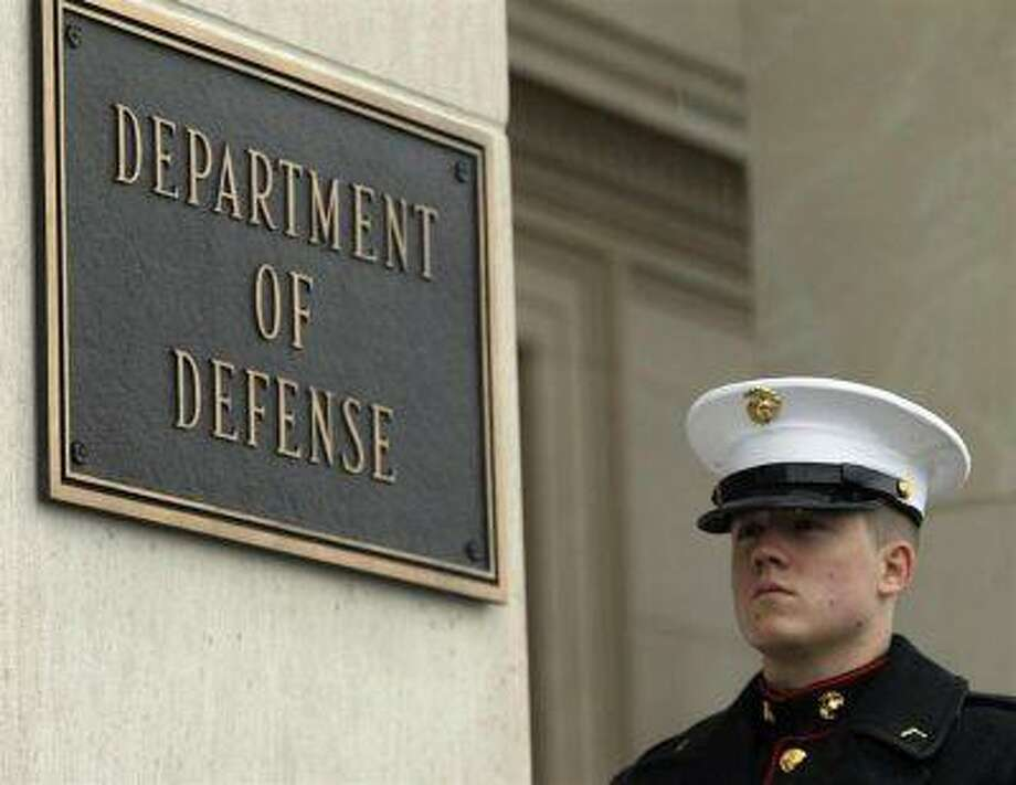 A United States Marine stands by his post in front of the Pentagon in Washington February 29, 2012. / X00044