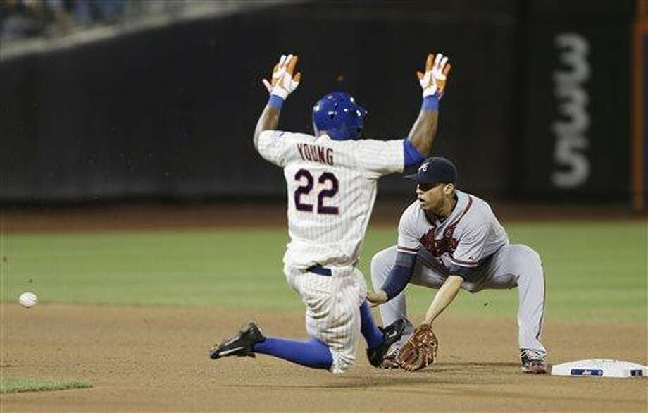 New York Mets' Eric Young Jr. (22) attempts to steal second base as Atlanta Braves' Andrelton Simmons waits for the ball during the seventh inning of a baseball game Tuesday, July 23, 2013, in New York. Young was out on the play. (AP Photo/Frank Franklin II) Photo: AP / AP