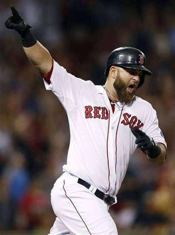 Boston Red Sox's Mike Napoli celebrates his solo home run in the 11th inning of a baseball game against the New York Yankees in Boston, Monday, July 22, 2013. The Red Sox won 8-7. (AP Photo/Michael Dwyer) Photo: AP / AP