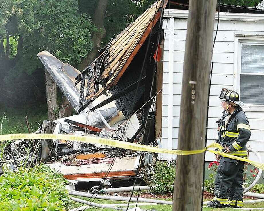 Plane crash that hit two houses at 64 and 68 Charter Oak Avenue between James and Gordon Streets in East Haven, Connecticut Friday afternoon, August 9. 2013. Photo by Peter Hvizdak - Register Photo: New Haven Register / ©Peter Hvizdak /  New Haven Register