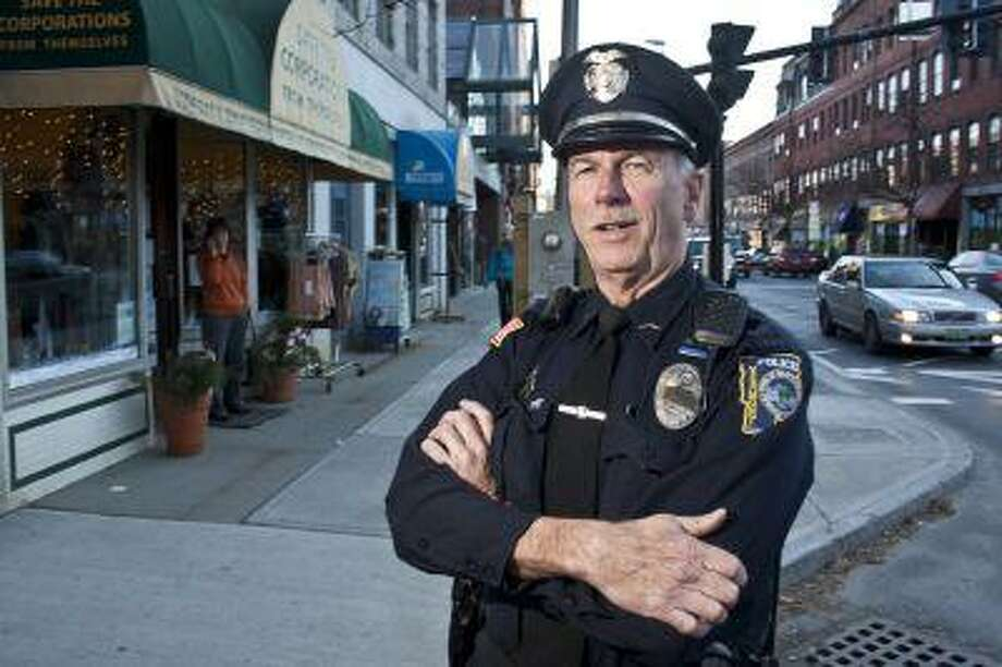 "Officer John ""Zippo"" Frechette stands on Main Street in Brattleboro on one of his last days on the Brattleboro Police Department before retiring."