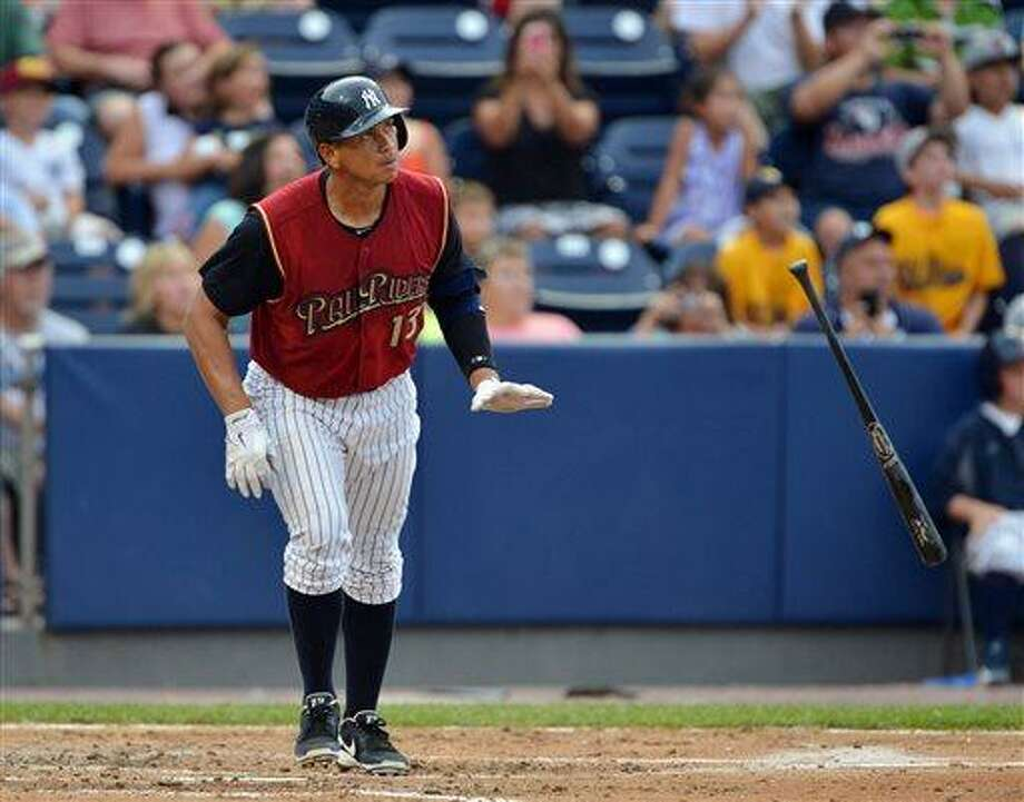 New York Yankees' Alex Rodriguez, playing for the Scranton/Wilkes-Barre RailRiders in a rehab assigment, tosses his bat as he watches his home run against the Louisville Bats in a baseball game Thursday, July 18, 2013, in Moosic, Pa. (AP Photo/The Scranton Times-Tribune, Jason Farmer) Photo: AP / The Scranton Times-Tribune