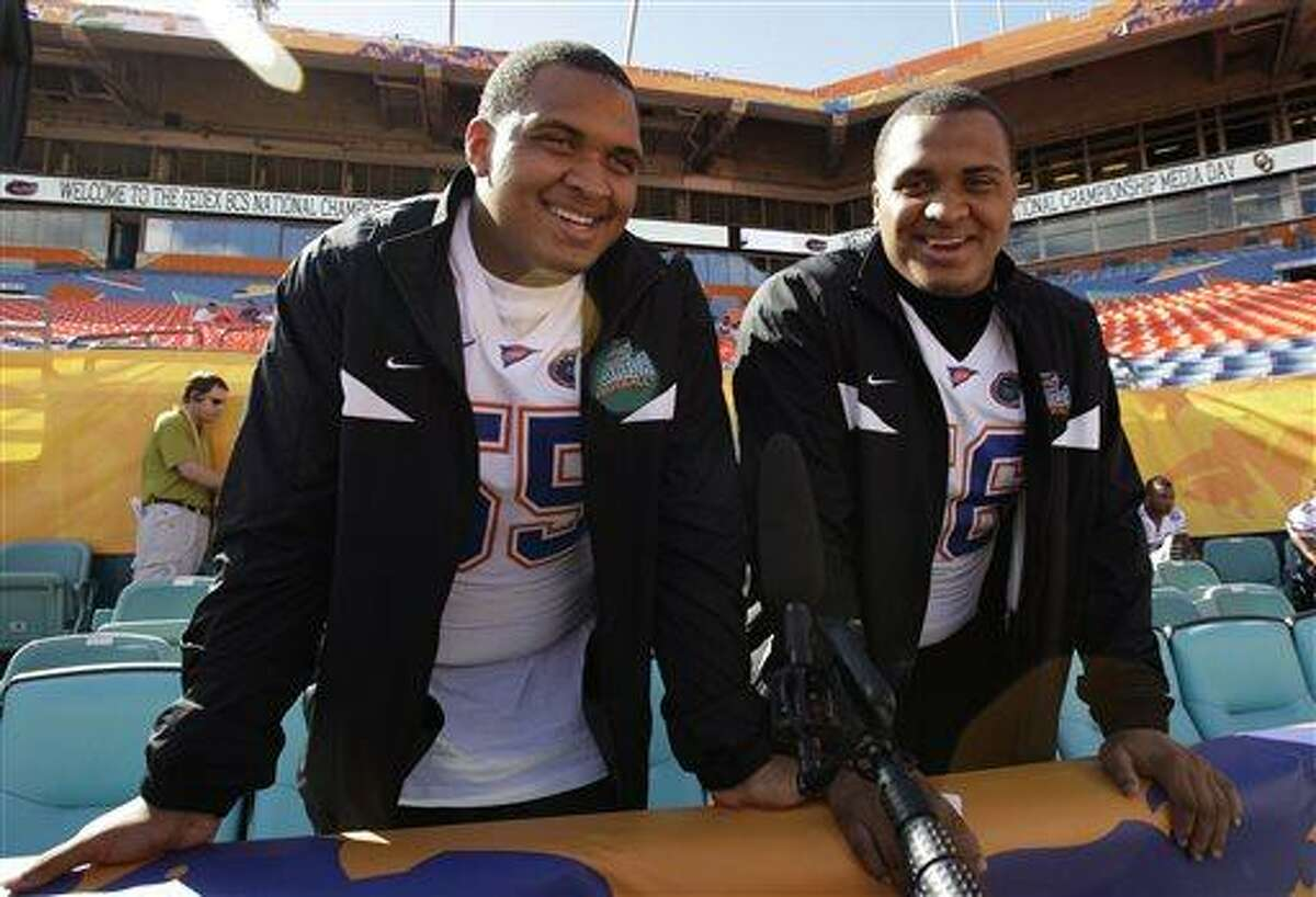 """FILE - In this Jan. 5, 2009 file photo, University of Florida teammates and twin brothers Mike, left, and Maurkice Pouncey smiles during media day at Dolphins Stadium in Miami. Pittsburgh Steelers All-Pro center Maurkice Pouncey has apologized for wearing a baseball cap supporting former college teammate Aaron Hernandez. Pouncey and his twin brother Mike, a center for the Miami Dolphins, were photographed wearing hats that read """"Free Hernandez"""" during their co-birthday party in Miami on Saturday night, July 13, 2013. Hernandez played at the University of Florida with the Pounceys from 2007-09. (AP Photo/Lynne Sladky)"""