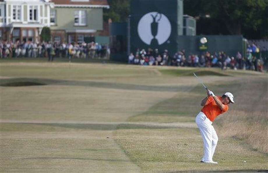 Lee Westwood of England plays a shot on the 18th hole during the third round of the British Open Golf Championship at Muirfield, Scotland, Saturday July 20, 2013. (AP Photo/Peter Morrison) Photo: AP / AP