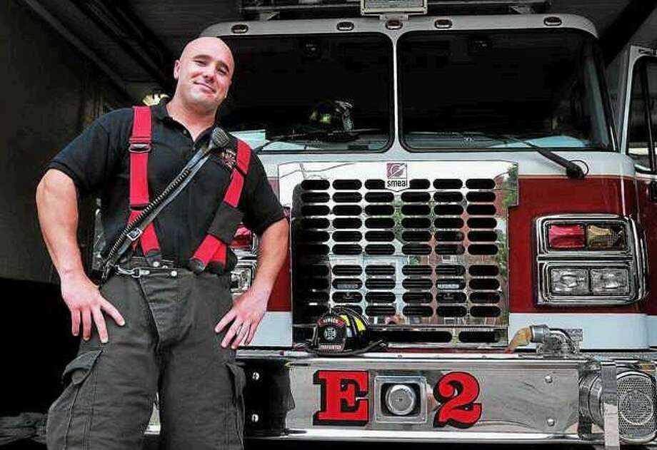 "Hamden's newest firefighter, Casey Blake, a former East Haven firefighter, is now working at the Circular Avenue station. Peter Casolino -- Register <a href=""mailto:pcasolino@newhavenregister.com"">pcasolino@newhavenregister.com</a>"