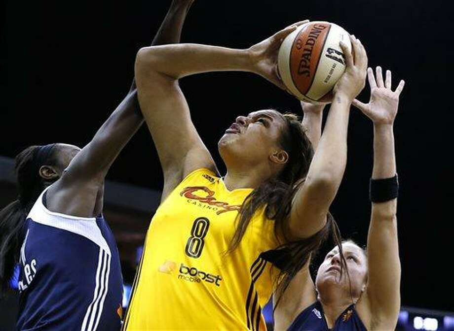 Tulsa Shock's Elizabeth Cambage (8) shoots against Connecticut Sun's Tina Charles, left, and Kelsey Griffin during a WNBA basketball game Friday, July 19, 2013, in Tulsa, Okla. (AP Photo/Tulsa World, Cory Young) Photo: AP / Tulsa World