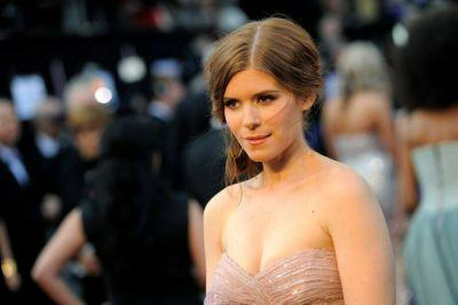 "In this Sunday, Feb. 26, 2012 file photo, Kate Mara arrives before the 84th Academy Awards, in the Hollywood section of Los Angeles. ""House of Cards"" actress Mara won't be announcing the 2013 Emmy nominations Thursday morning, July 18, 2013. The Academy of Television Arts and Sciences said Mara's plane had a mechanical malfunction and couldn't take off from Santa Fe, where she is on location. (AP Photo/Chris Pizzello, File) Photo: AP / AP"