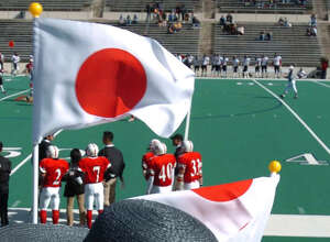 (1/28/04) Naoko Maeda of Tokyo, Japan, waves a Japanese flag, during the game between Japan vs. Canada, Wednesday afternoon, January 28, 2003, during the NFL Global Junior Championship VIII First Round Jamboree, at Tully Stadium. Maeda's son, Yudai Maeda was playing in the game for Japan. (Karen Warren/Houston Chronicle)