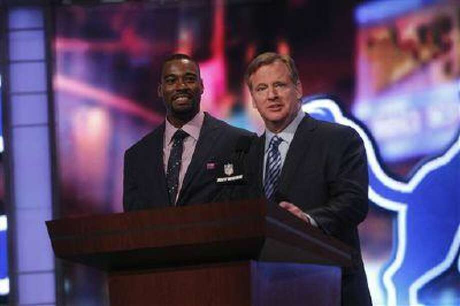 Detroit Lions wide receiver Calvin Johnson, left, and NFL Commissioner Roger Goodell appear onstage during the first round of the NFL football draft at Radio City Music Hall, April 26, 2012, in New York. Photo: AP / FR103966 AP