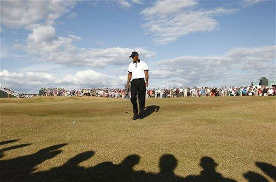 Tiger Woods of the United States looks at his ball on the 14th green during the first round of the British Open Golf Championship at Muirfield, Scotland, Thursday July 18, 2013. (AP Photo/Jon Super) Photo: AP / AP