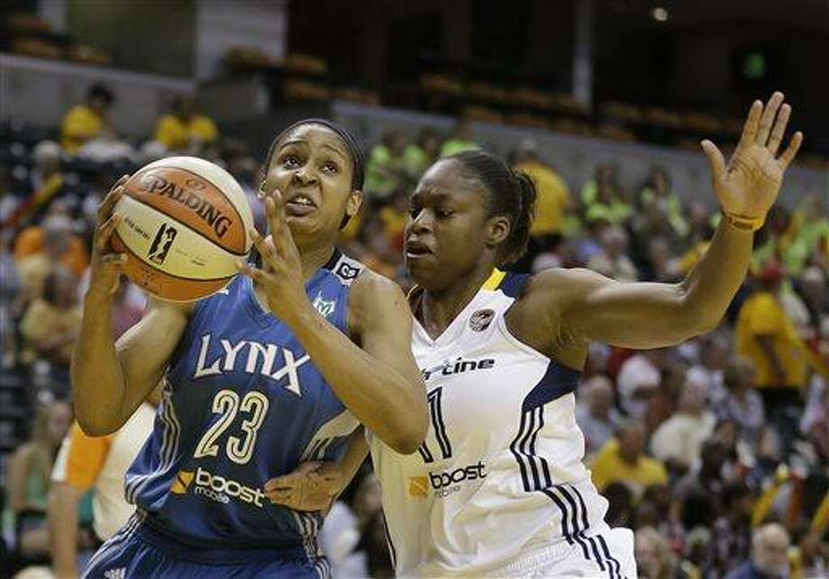 Minnesota Lynx's Maya Moore goes to the basket against Indiana Fever's Karima Christmas during the first half of a WNBA basketball game Thursday, July 11, 2013, in Indianapolis. (AP Photo/Darron Cummings) Photo: AP / AP