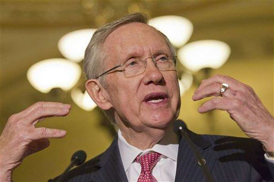 Senate majority leader Harry Reid gestures as he speaks to the media as lawmakers moved toward resolving their feud over filibusters of White House appointees on Capitol Hill in Washington, Tuesday, July 16, 2013. (AP Photo/Jacquelyn Martin) Photo: AP / AP