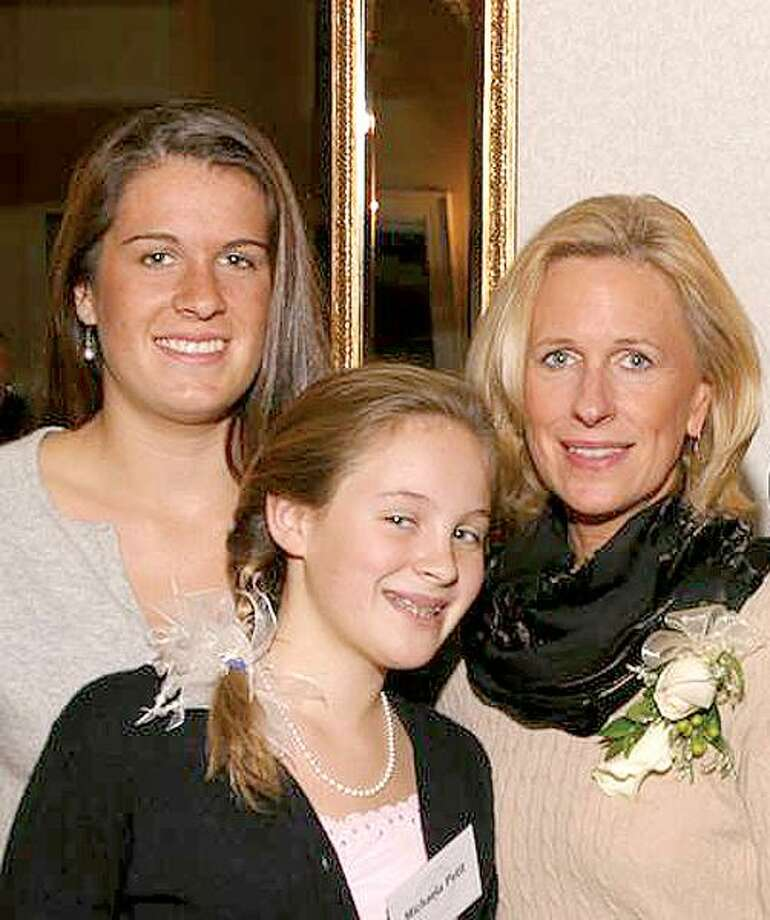 17-year-old Hayley, 11-year-old Michaela and Jennifer Hawke-Petit in an undated family photo.