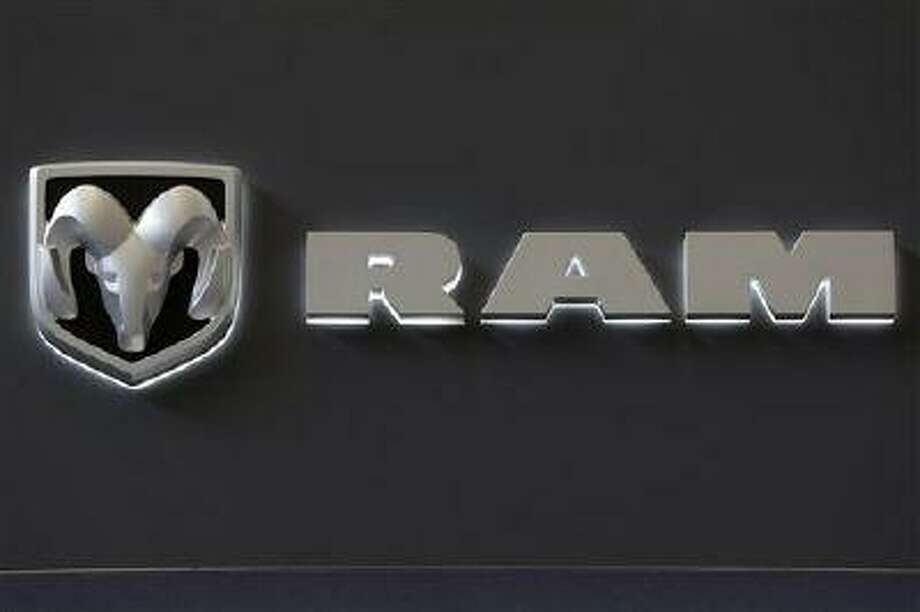 In this Feb. 14, 2013 photo, the Dodge Ram truck logo appears on a sign at the 2013 Pittsburgh Auto Show in Pittsburgh. Sales from the major automakers are expected to show that confident U.S. buyers snapped up new cars and trucks at a strong pace in June. Chrysler said Tuesday, July 2, 2013, that its sales rose 8 percent for its best June since 2007. Ram brand sales rose 23 percent and Dodge sales were up 12 percent on the strength of the Dodge Dart small car. (AP Photo/Gene J. Puskar) Photo: AP / AP