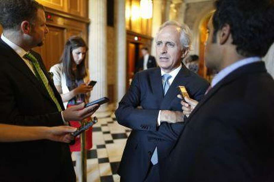 U.S. Senator Bob Corker (R-TN) talks to reporters near the U.S. Senate floor at the U.S. Capitol during immigration debates in Washington, June 20, 2013. An army of new federal agents and high-tech surveillance devices would be dispatched to the U.S.-Mexican border under a deal reached on Thursday that is aimed at winning increased Republican support for an immigration bill in the U.S. Senate. REUTERS/Jonathan Ernst (UNITED STATES - Tags: POLITICS SOCIETY IMMIGRATION) Photo: REUTERS / X01676