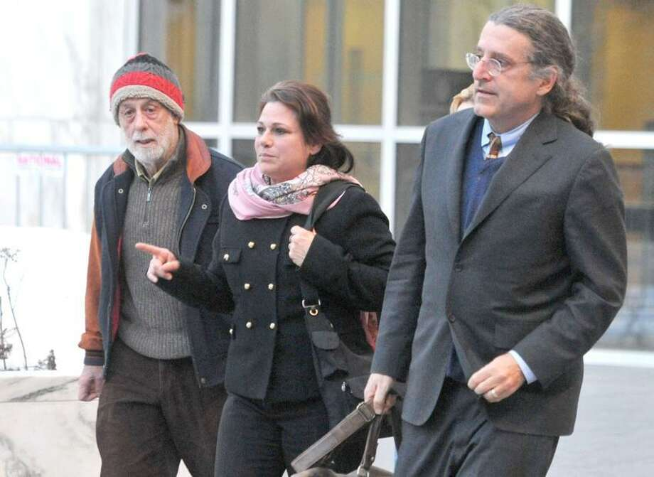 Hartford-- Donna Bello leaves court in Hartford with her husband Joel Schiavone, left, and her attorney Norm Pattis.  Photo-Peter Casolino