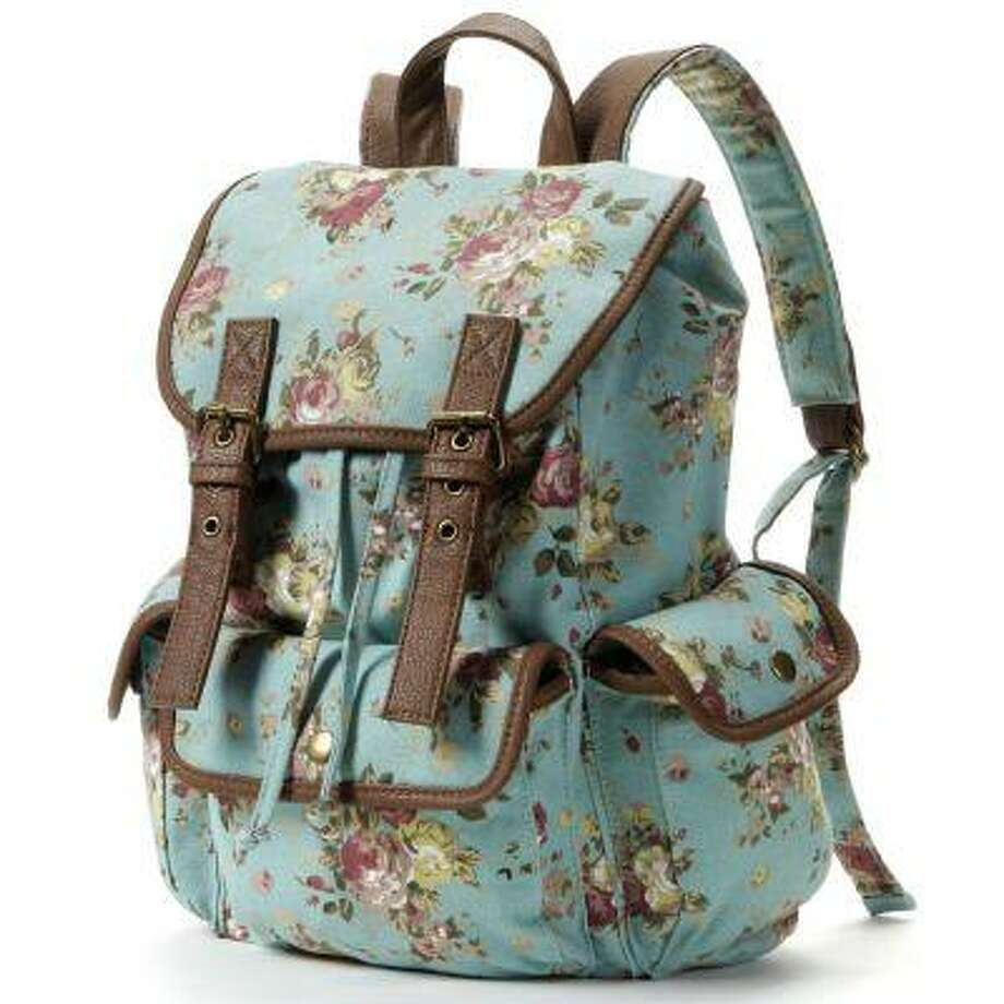 """This publicity photo provided by Kohl's Department Stores, Inc. shows a backpack with a floral motif. Backpacks are a fashionable and functional way for students to express their personality and show off their style,"""" said Sofia Wacksman, Kohl's VP for Trend. Girls would love the cute colored leopard, boho floral, and fun graphic hearts, and plaids, moustaches, leaf prints and skulls round out the range available this season (www.kohls.com). (AP Photo/Kohl's Department Stores, Inc.) Photo: AP / Kohl's Department Stores"""
