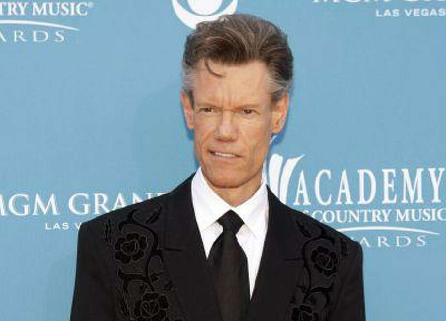 Singer Randy Travis arrives at the 45th annual Academy of Country Music Awards in Las Vegas, Nevada in this April 18, 2010 file photo. y to relieve pressure on his brain. He is in critical condition, according to a family spokesman. REUTERS/Steve Marcus/Files Photo: REUTERS / X00642