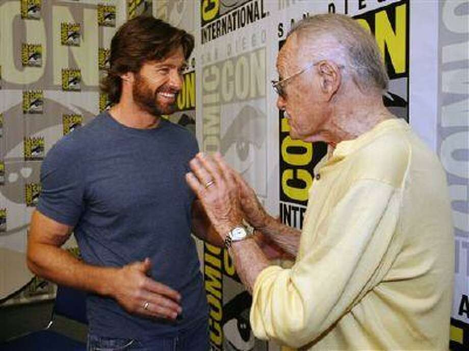 "FILE - In this July 24, 2008 file photo, actor Hugh Jackman, left, talks to legendary comic book creator Stan Lee, right, after an interview at the Comic-Con 2008 convention in San Diego. Attending Comic-Con is often a once-in-a-lifetime opportunity for many con-goers, but it's just another summertime destination for the likes of ""The Wolverine"" star Jackman, geeky funnyman Patton Oswalt and ""The Amazing Spider-Man"" sequel writers Alex Kurtzman and Roberto Orci. (AP Photo/Denis Poroy) Photo: AP / FR59680 AP"