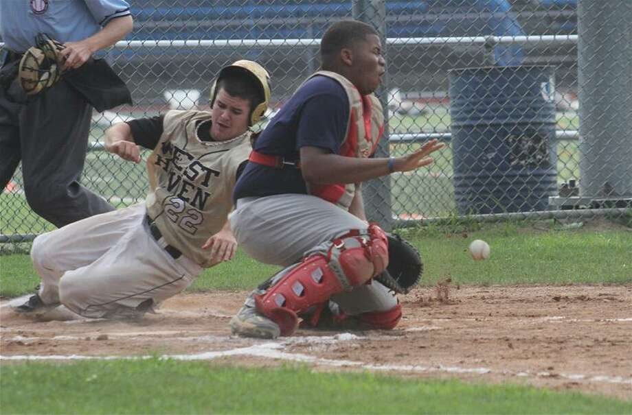 Photo by Russ McCreven <br> West Haven's Tyler Gambardella slides safely into home during Post 71's 3-1 victory over Stratford in the first game of a doubleheader Monday in West Haven.
