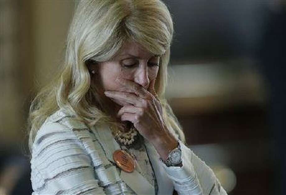 Sen. Wendy Davis, D-Fort Worth, reacts after she was called for a rules violation during her filibusters of an abortion bill, Tuesday, June 25, 2013, in Austin, Texas. Davis was given a second warning for breaking filibuster rules. (Eric Gay/AP) Photo: AP / AP