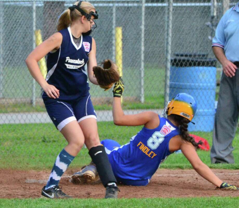 Melanie Stengel -- Register State Little League Softball Championship Game 2 7/15. Seymour vs, Pawcatuck.  Seymour's Rebecca Findley takes 3rd base before  Pawcatuck's Lainnie Connor can make the tag in 6th inning action. Photo: New Haven Register / ©PMelanoie Stengel/ New Haven Register