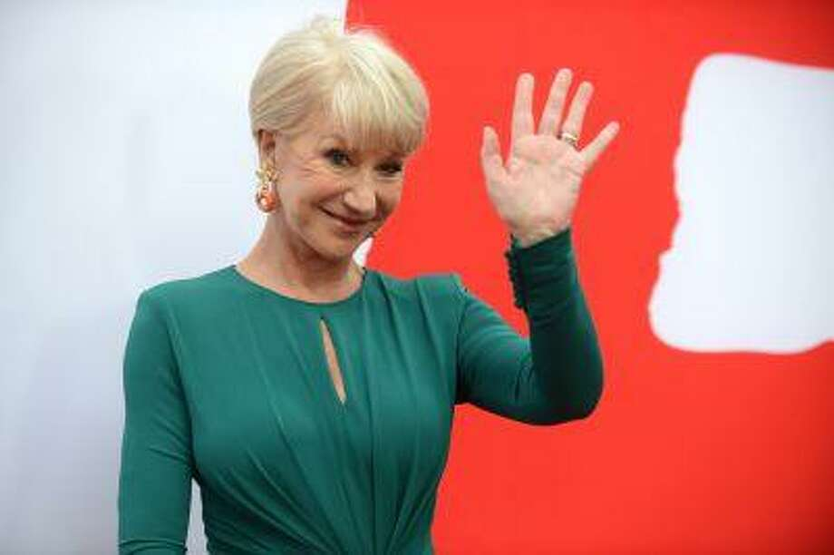 """Helen Mirren arrives at the LA premiere of """"Red 2"""" at the Westwood Village on Thursday, July 11, 2013, in Los Angeles. (Photo by Jordan Strauss/Invision/AP) Photo: Jordan Strauss/Invision/AP / AP2013"""