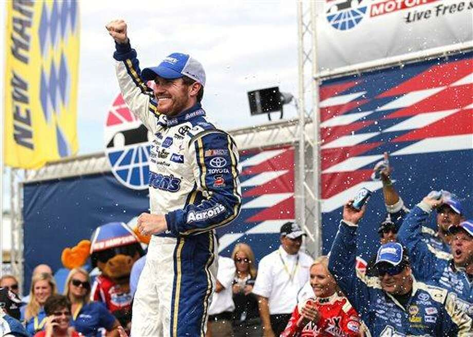 Brian Vickers celebrates in Victory Lane after winning the NASCAR Sprint Cup Series auto race at New Hampshire Motor Speedway in Loudon, N.H., Sunday, July 14, 2013.  (AP Photo/Cheryl Senter) Photo: AP / FR62846 AP