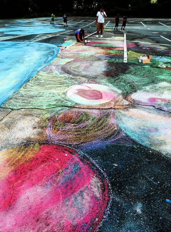 West Haven is looking to break a world record for the biggest chalk drawing in the West Haven High School Parking Lot. Peter Hvizdak - Register Photo: New Haven Register / ©Peter Hvizdak /  New Haven Register