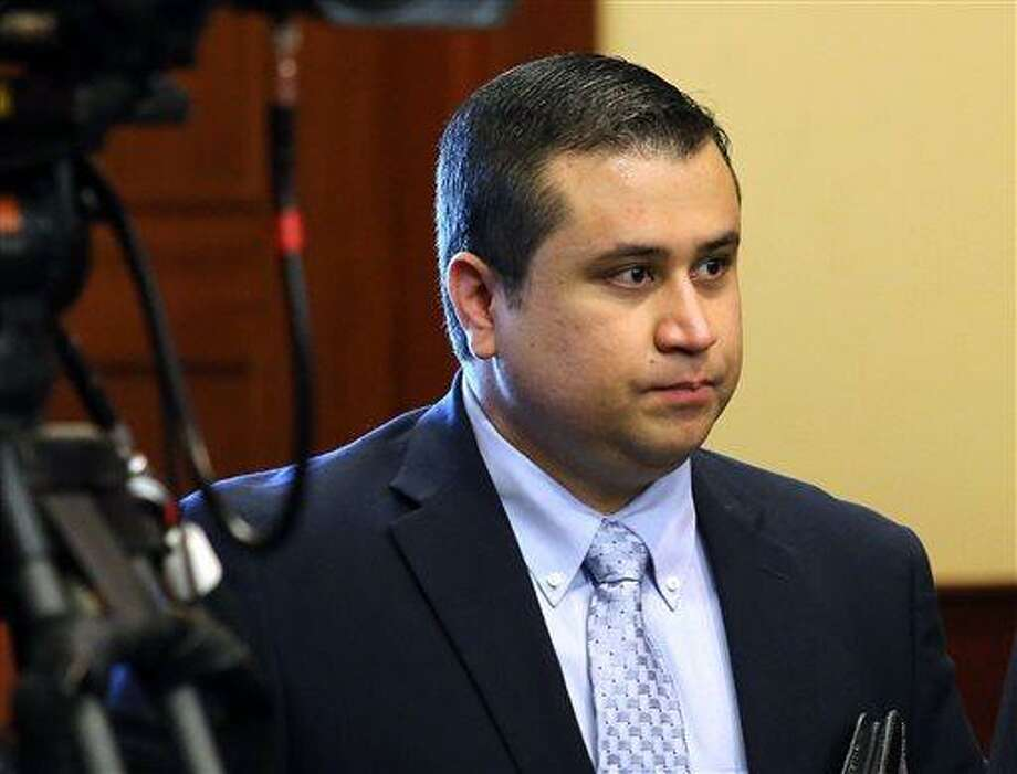 George Zimmerman arrives in the courtroom for his trial at the Seminole County Criminal Justice Center, in Sanford, Fla., Friday, July 12, 2013.  Zimmerman is charged in the 2012 shooting death of unarmed teenager Trayvon Martin. (AP Photo/Orlando Sentinel, Joe Burbank, Pool) Photo: AP / Pool Orlando Sentinel