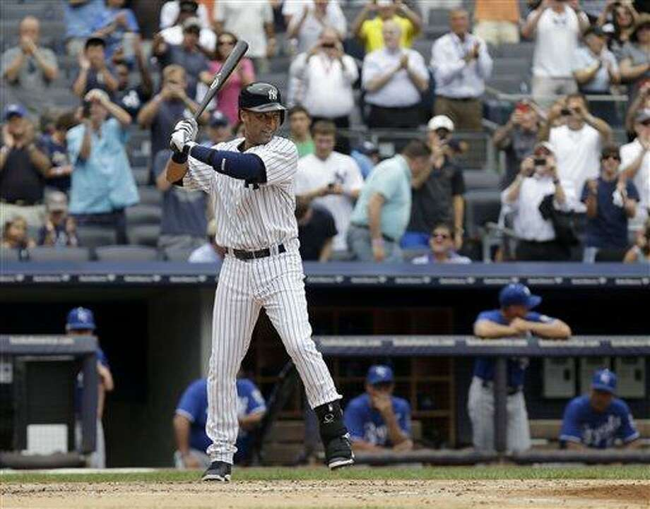 New York Yankees' Derek Jeter takes a practice swing before batting during the first inning of the baseball game against the Kansas City Royals at Yankee Stadium Thursday, July 11, 2013 in New York. (AP Photo/Seth Wenig) Photo: AP / AP