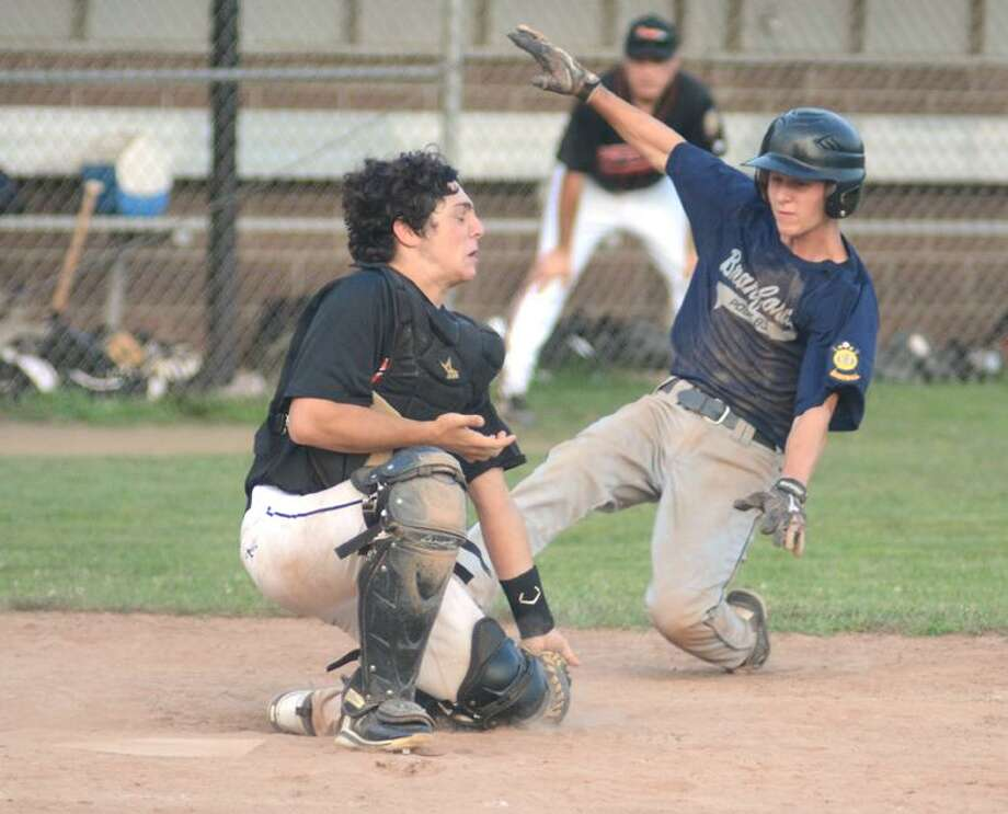 Photo by Dave Phillips <br> Branford's Mike Funaro scores the game-winning, and Zone II title-clinching, run in the bottom of the seventh inning of Post 83's 1-0 victory over Orange Wednesday night in Branford.