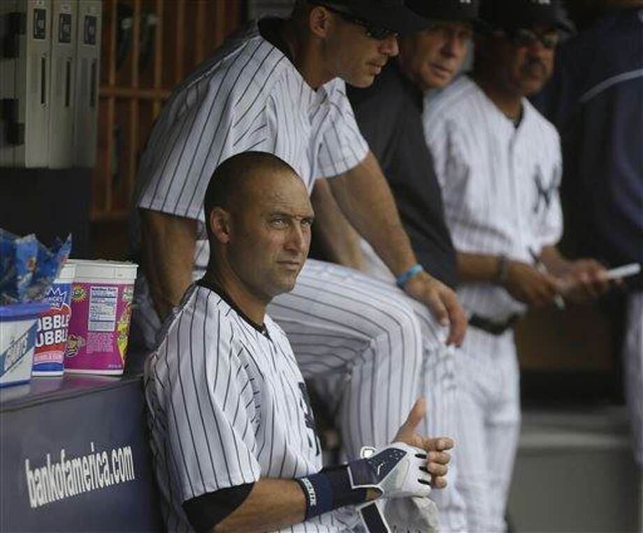New York Yankees' Derek Jeter in the dugout during the fifth inning of the baseball game against the Kansas City Royals at Yankee Stadium Thursday, July 11, 2013 in New York. (AP Photo/Seth Wenig) Photo: AP / AP