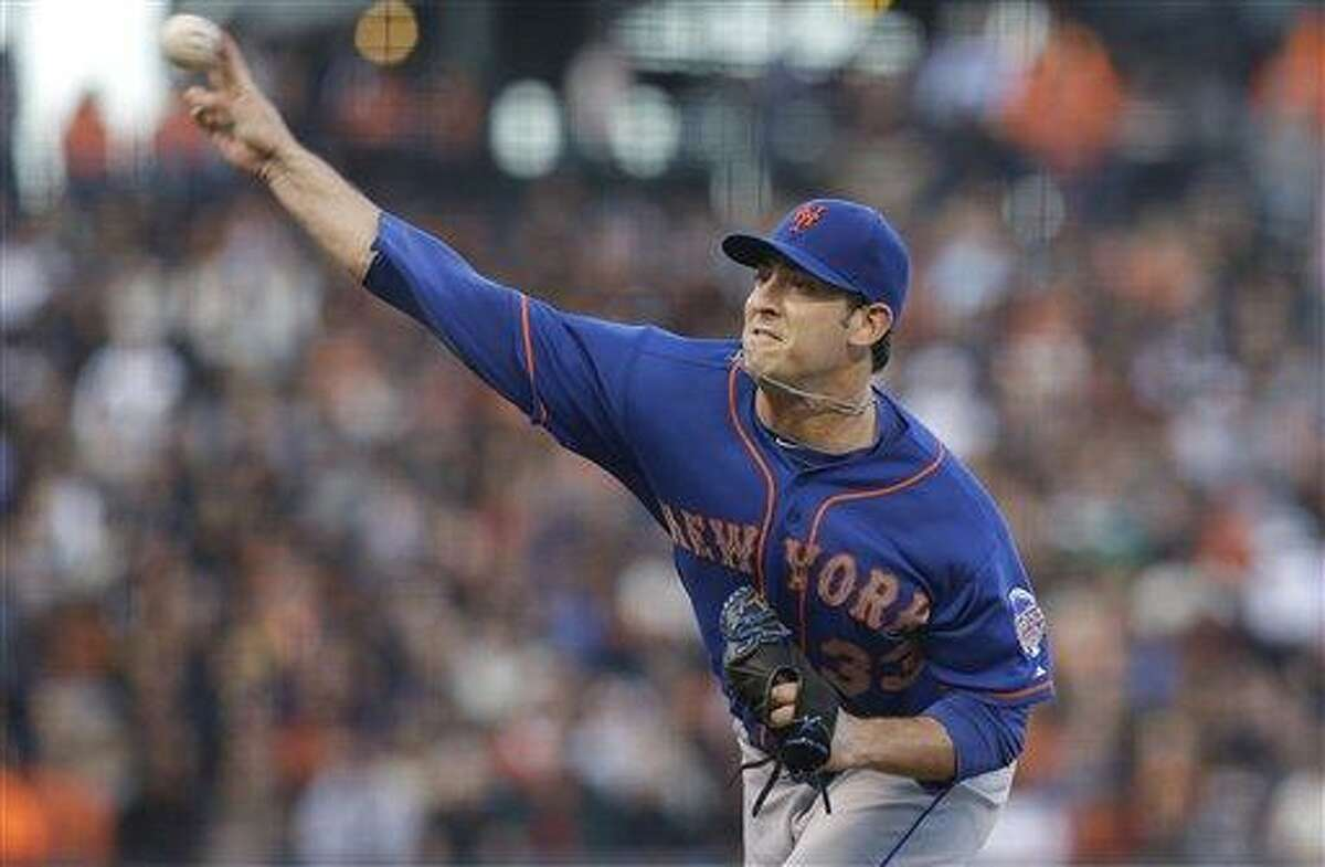 New York Mets pitcher Matt Harvey throws against the San Francisco Giants during the second inning of a baseball game in San Francisco, Monday, July 8, 2013. (AP Photo/Jeff Chiu)