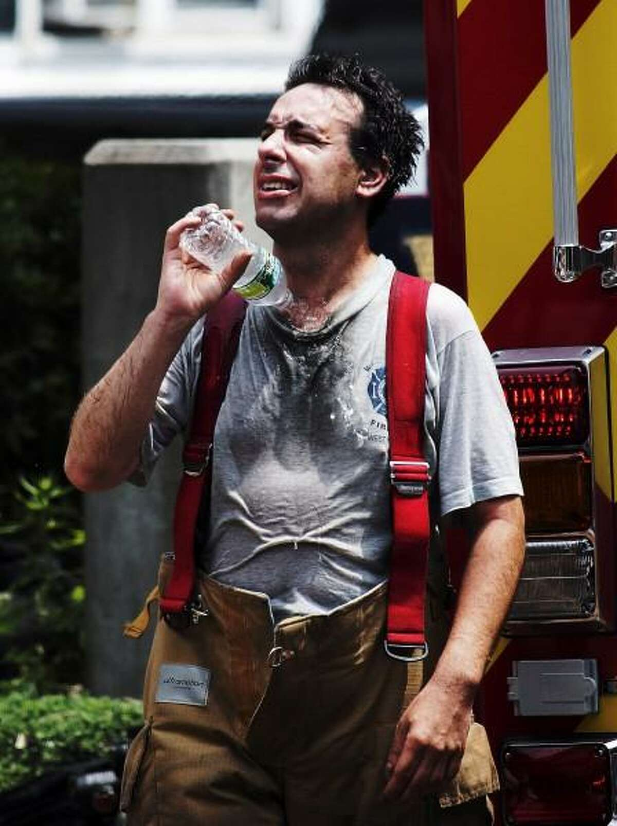 Peter Casolino/New Haven Register West Haven Firefighter Lt. Russell Lariviere cools off as Firefighters from several districts in West Haven battled a blaze at 817 Campbell Ave in the early afternoon on Tuesday. pcasolino@newhavenregister.com
