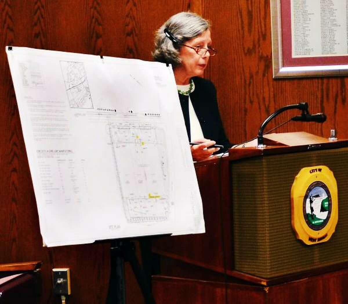 Melanie Stengel/New Haven Register Attorney Diane Whitney, of the law firm Pullmam and Comley, listens to a question about the proposed use of a building on Frontage Rd., in West Haven, as a medical marijuanna facility 8/9.