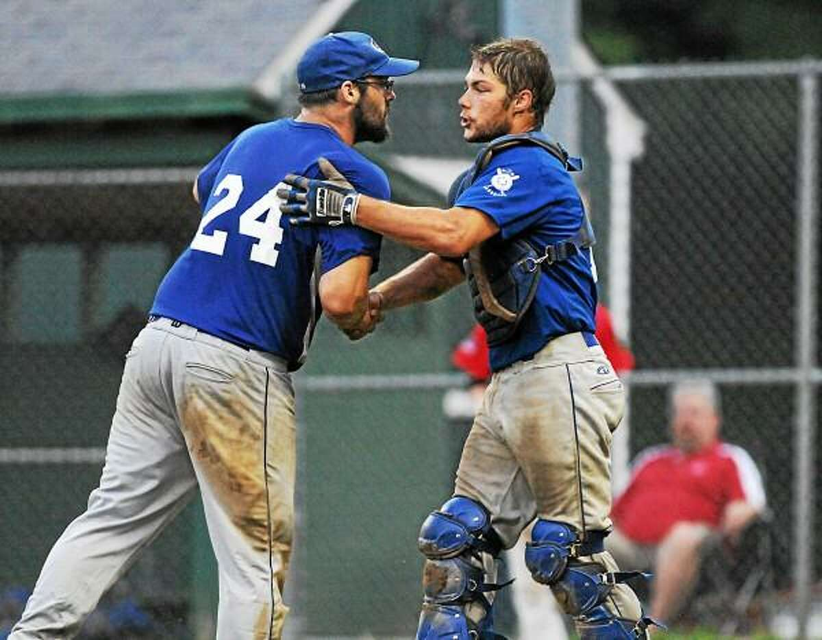 East Haddam relief pitcher Adam Michaud comes off the mound at the end of the game to speak with long time teammate catcher Spencer Daly after his save against Middletown Post 75 Tuesday evening at Memorial Field in East Haddam. Post 156 defeated Post 75 5-2 in an American Legion Zone 3 game. Photo by Catherine Avalone - The Middletown Press