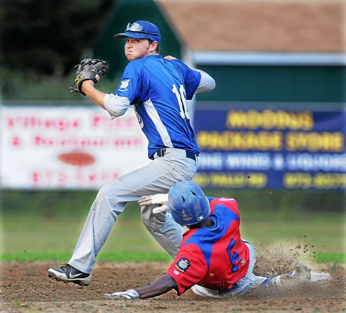 Middletown's Malcolm Allyene is forced out at second by East Haddam 's Troy DeLeone Tuesday evening at Memorial Field in East Haddam. Post 156 defeated Middletown 5-2. Photo by Catherine Avalone - The Middletown Press