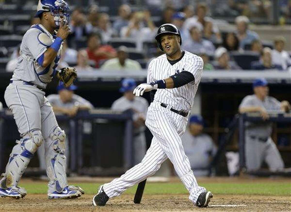 New York Yankees' Robinson Cano reacts after striking out swinging with a runner on second in the eighth inning of a baseball game against the Kansas City Royals, Tuesday, July 9, 2013, in New York. Royals catcher Salvador Perez is at left. (AP Photo/Kathy Willens)