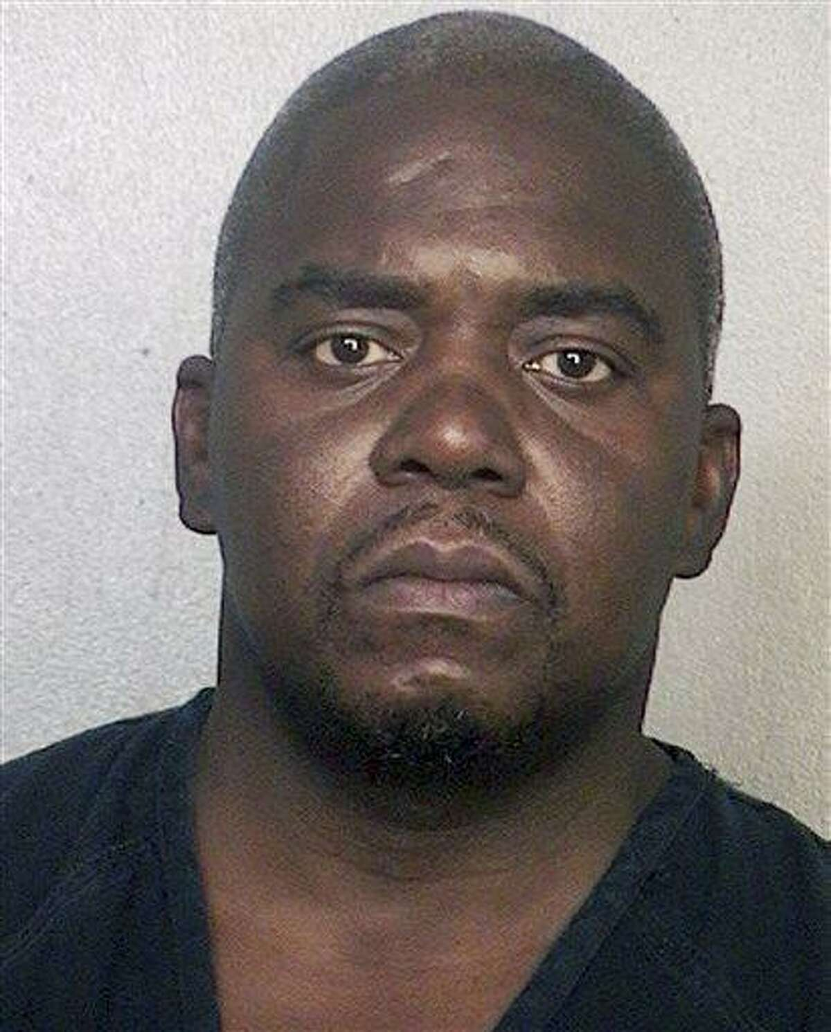 This booking photo released via the website of the Broward County Sheriff's Office shows Ernest Wallace, arrested June 28, 2013 when he surrendered at a police station in Miramar, Fla. Authorities had been seeking Wallace on a charge of acting as an accessory after the murder of Odin Lloyd on June 17 in North Attleborough, Mass. Former New England Patriots tight end Aaron Hernandez has been charged with Lloyd's murder. (AP Photo/Broward County Sheriff's Office)
