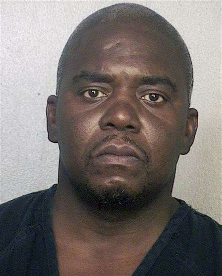 This booking photo released via the website of the Broward County Sheriff's Office shows Ernest Wallace, arrested June 28, 2013 when he surrendered at a police station in Miramar, Fla.  Authorities had been seeking Wallace on a charge of acting as an accessory after the murder of Odin Lloyd on June 17 in North Attleborough, Mass. Former New England Patriots tight end Aaron Hernandez has been charged with Lloyd's murder. (AP Photo/Broward County Sheriff's Office) Photo: AP / Broward County Sheriff's Office
