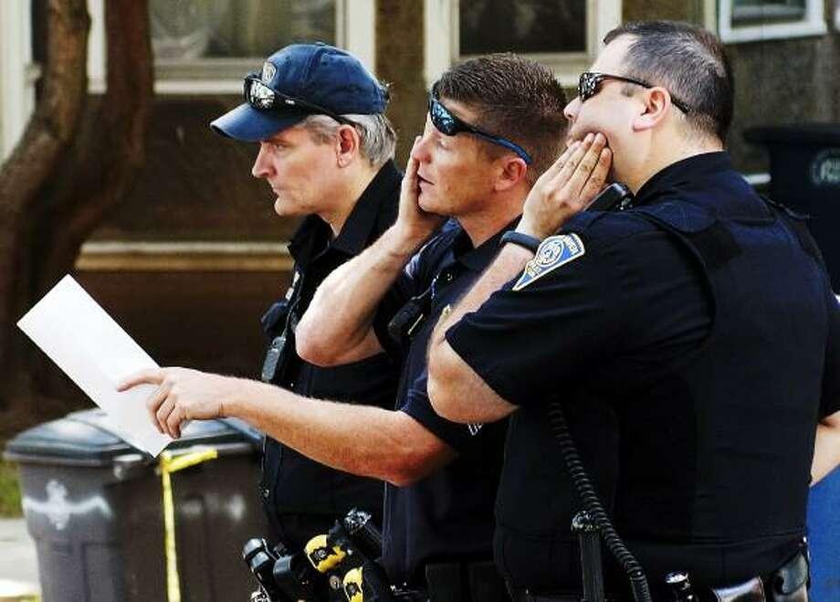 """Peter Casolino/New Haven Register New Haven Police investigate the scene along Ella Grasso Blvd. <a href=""""mailto:pcasolino@newhavenregister.com"""">pcasolino@newhavenregister.com</a>"""