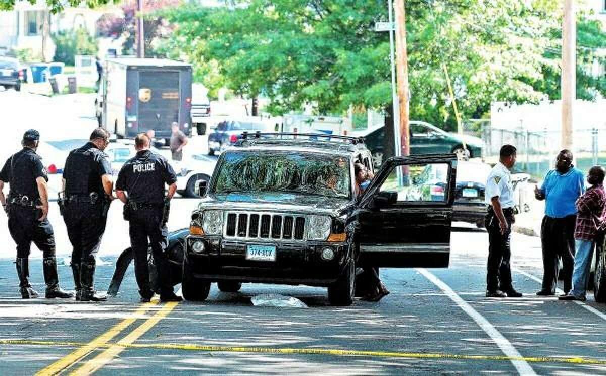 Peter Casolino/New Haven Register New Haven Police investigate the scene along Ella Grasso Blvd., where this SUV struck three children crossing the street around 2:40pm. Two girls were taken via ambulance to the hospital. pcasolino@newhavenregister.com