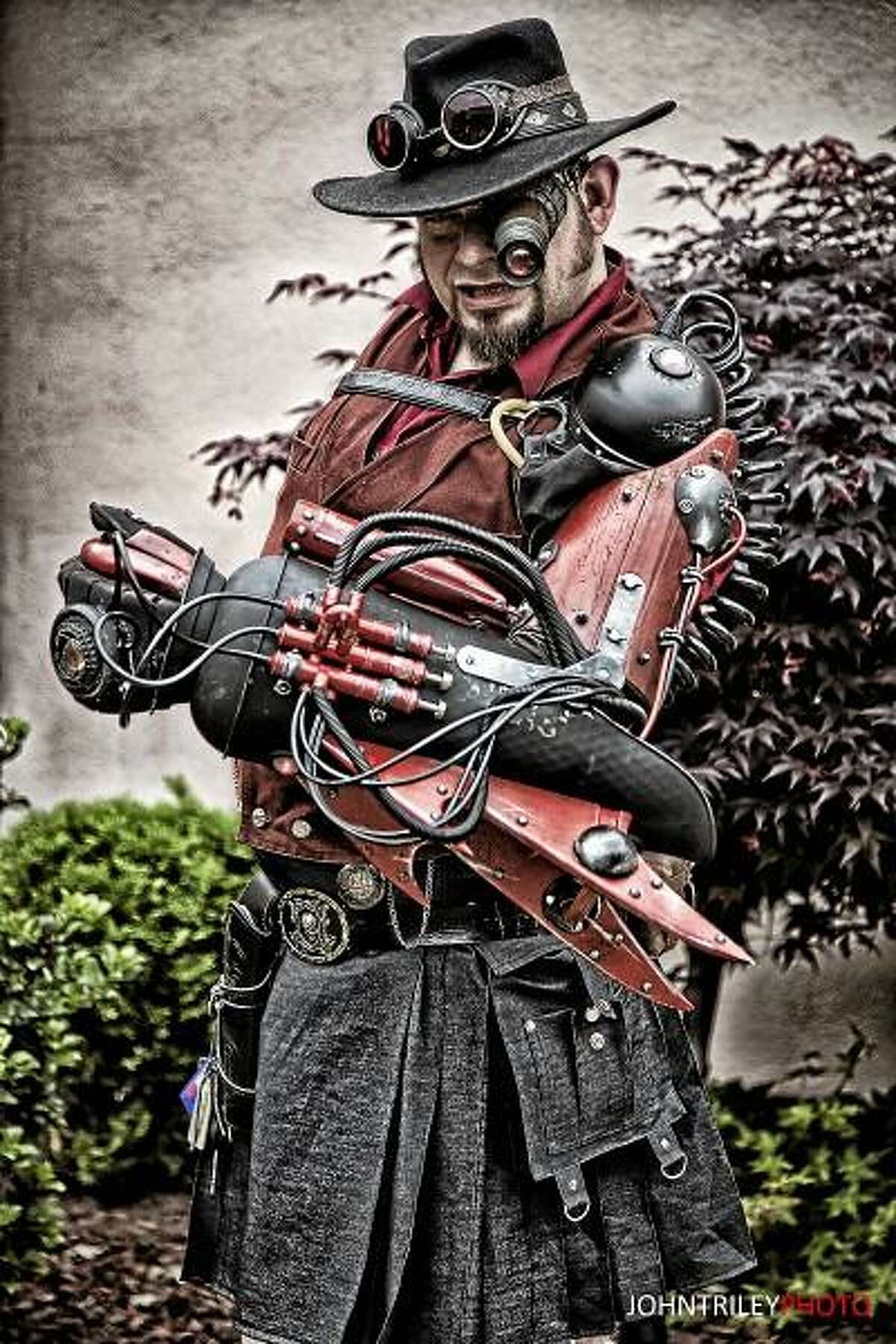 John T. Riley - Special to the Press Dr. Grymm, aka Joey Marsocci, is featured with a robotic arm and his character's costume that he designed and built.