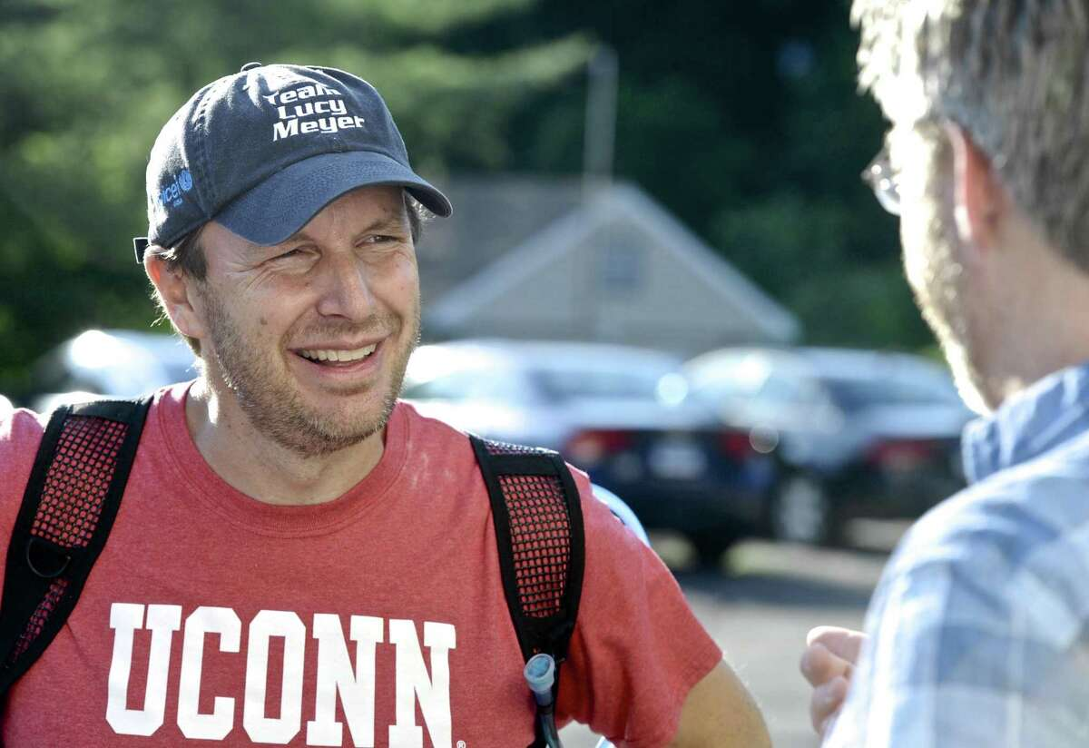 Sen. Chris Murphy stops to talk with Ryan Clancy, of Newtown, while walking across the state Wednesday.