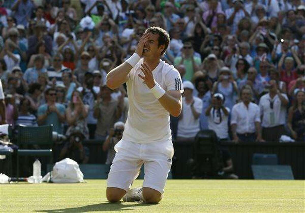 Andy Murray of Britain reacts after winning against Novak Djokovic of Serbia in the Men's singles final match at the All England Lawn Tennis Championships in Wimbledon, London, Sunday, July 7, 2013. (AP Photo/Kirsty Wigglesworth)