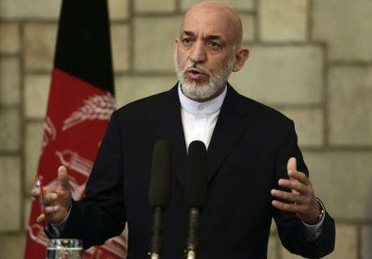 Afghan President Hamid Karzai speaks during a joint news conference with British Prime Minister David Cameron at the Presidential Palace in Kabul June 29, 2013. (Massoud Hossaini/Reuters/Pool)