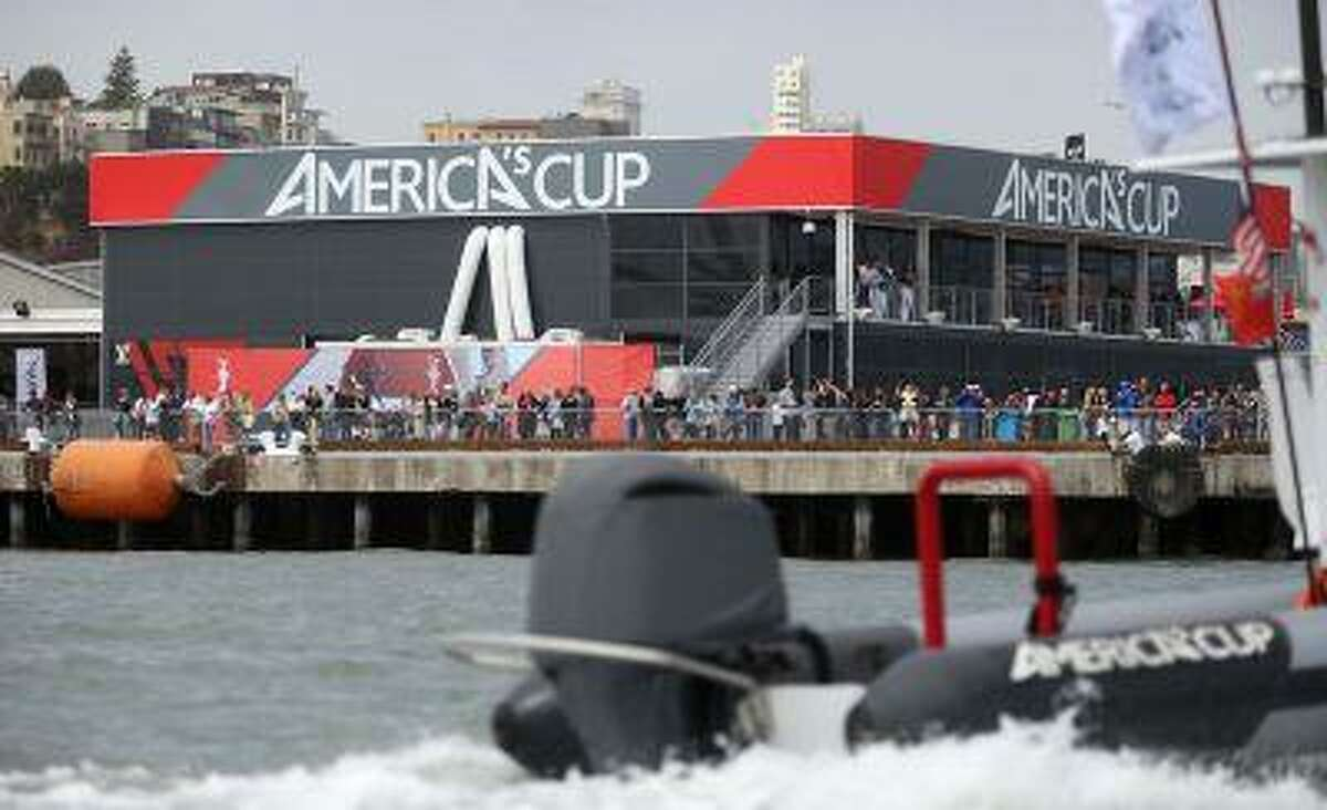 Spectators watch from the America's Cup park at Pier 27 during the America's Cup Parade of Boats in San Francisco, Calif., on Friday, July 5, 2013.